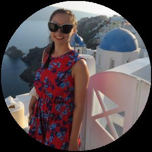 Profile picture in Santorini. Blue domes in the background.