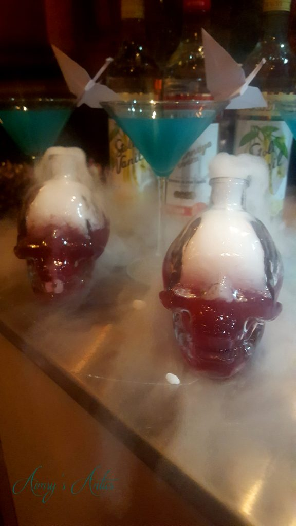 Cocltails - 2 in martini glasses and 2 in skull glasses