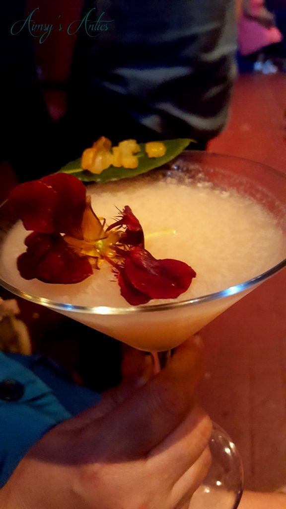 Cocktail with flower and leaf decoration