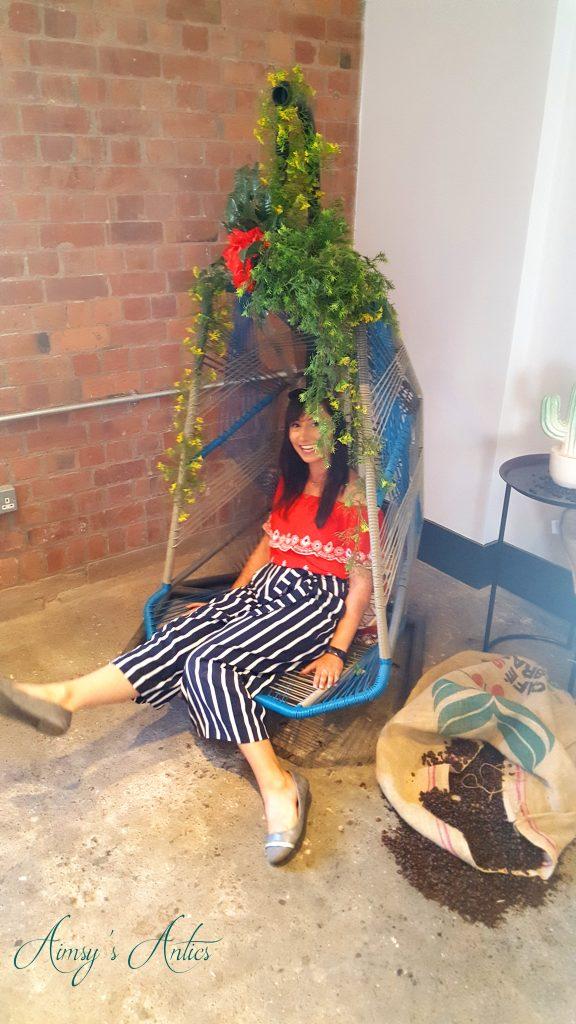 Female sat in swing chair