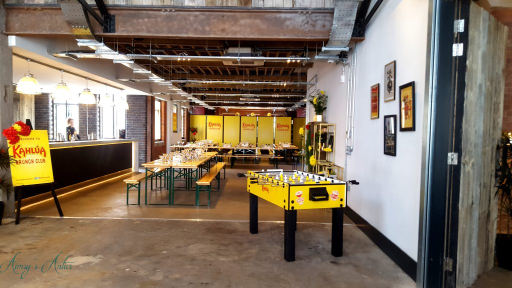View of The Loft, including long tables and fuse ball table