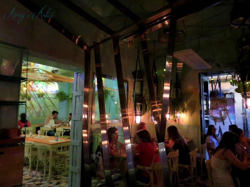 Inside Ojala Restaurant, Madrid with sliding glass dorr