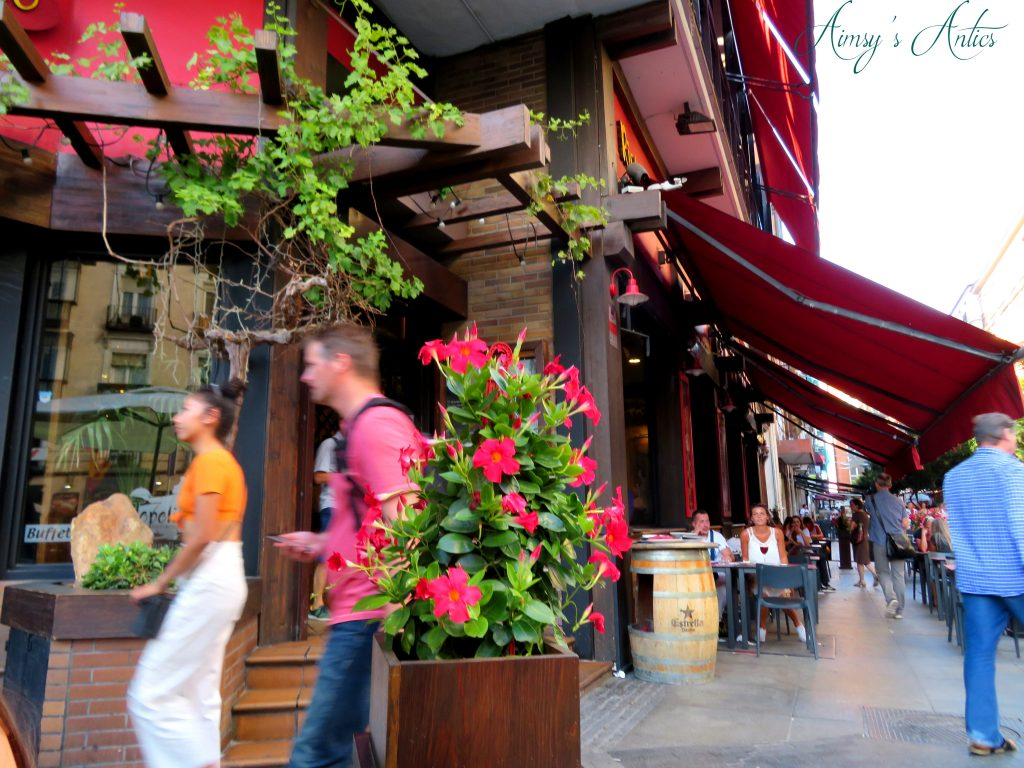 Outside Topolino restaurant with flower boxes