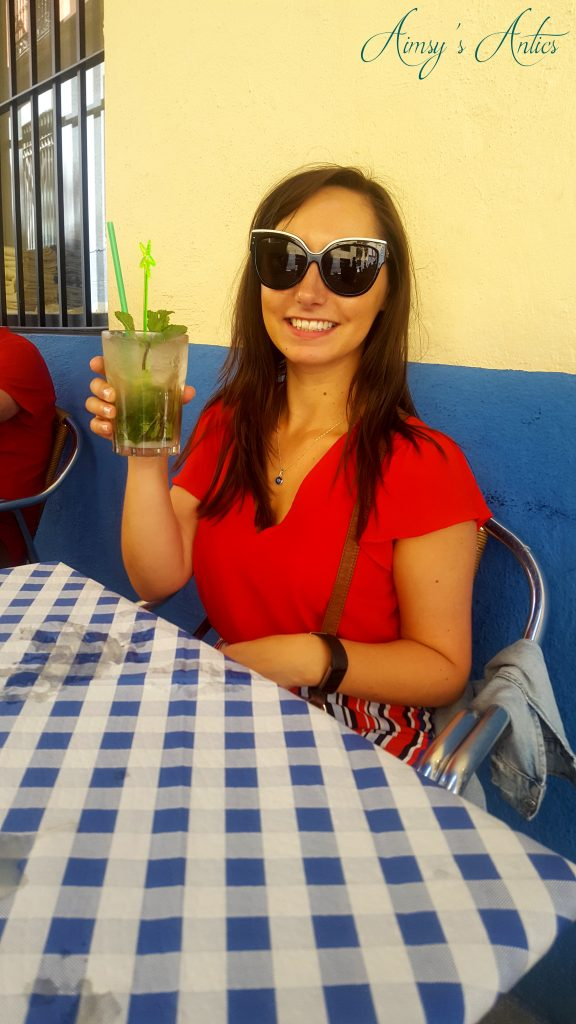 Woman holding a Mojito cocktail