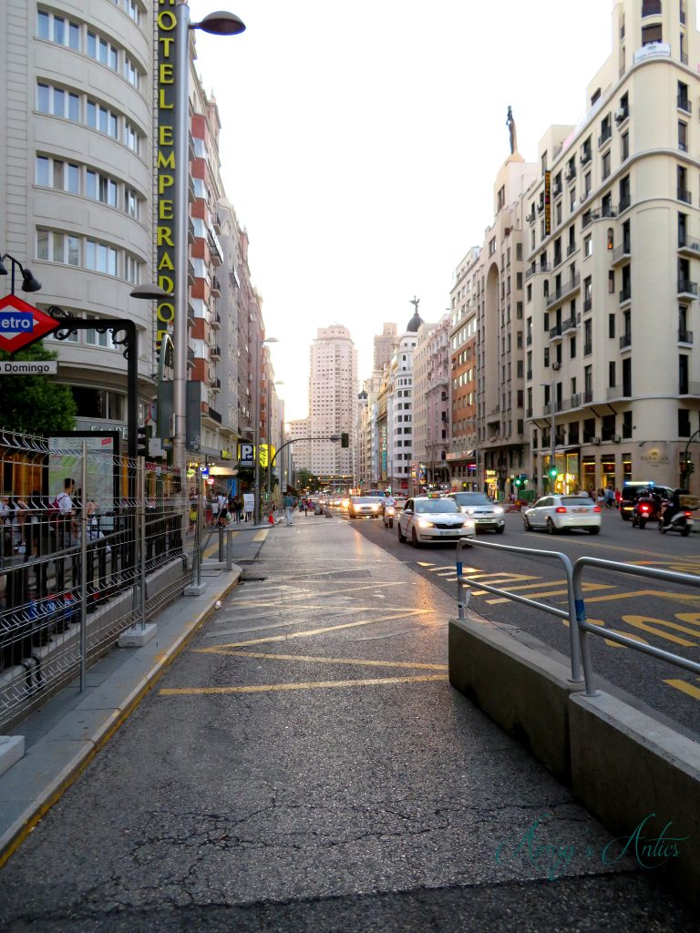 Madrid street with metro sign and cars
