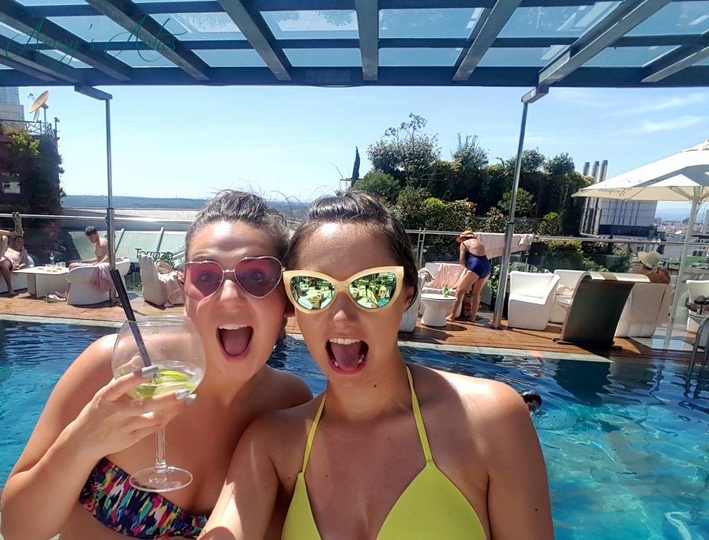 Two girls at Hotel Santo Domingo Pool with drink in hand